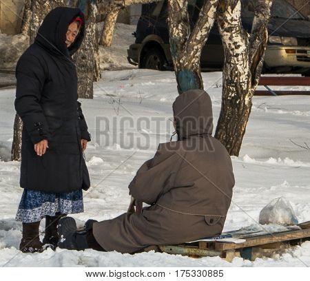 Kazakhstan, Ust-Kamenogorsk, 24 february, 2017: In the courtyard, two elderly women talking