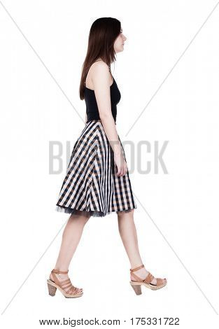back view of walking  woman in dress. beautiful brunette girl in motion.  backside view of person.  Rear view people collection. Isolated over white background. A smiling girl goes past us