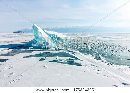 Winter Baikal lake landscape with Sun on blue sky.