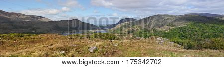 Irish Countryside with Hills and a River with Blue Sky