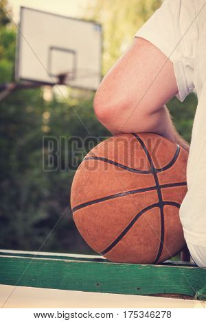 Basketball player making pause on the bench.