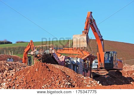 stone crusher and diggers on a construction site