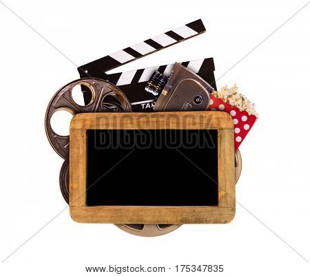 Retro film production accessories isolated on white background with blank blackboard for copyspace. Concept of film-making.