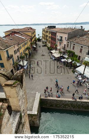 SIRMIONE ITALY - MAY 5 2016: View of Piazza Castello from the Scaliger Castle in Sirmione Lake Garda Italy
