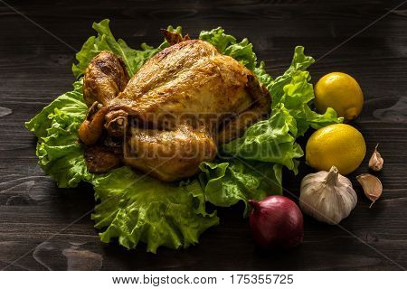 baked chicken on lettuce leaves and ingredients for cooking