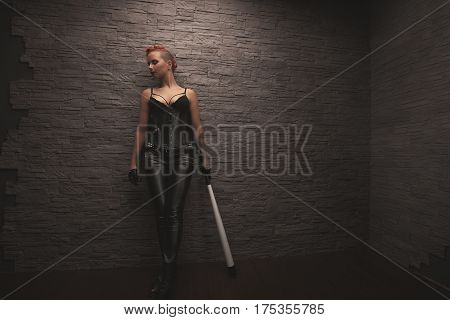 portrait of sexy dangerous girl with weapon