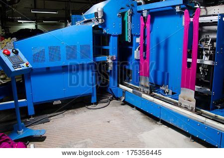 Cotton Yarn Production in a Textile Factory.Textile fabric manufacturing machines in work. Hoisery