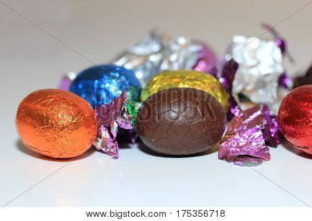 a group of foil wrapped chocolate easter eggs