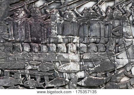 Ancient reliefs on the temple wall in Angkor Thom, Cambodia