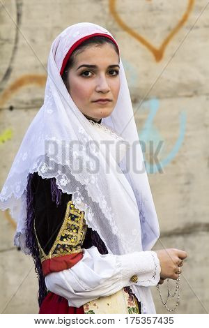 CAGLIARI, ITALY - May 1, 2015: 359 Religious Procession of Sant'Efisio - portrait of a beautiful woman in traditional Sardinian costume - Sardinia