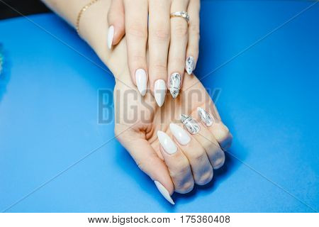 Manicure. The Woman Cleans And Paints Nails. The Woman Processes Nails On Hands A Varnish. Shelak. G