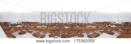 Snow covered red brick wall isolated on white