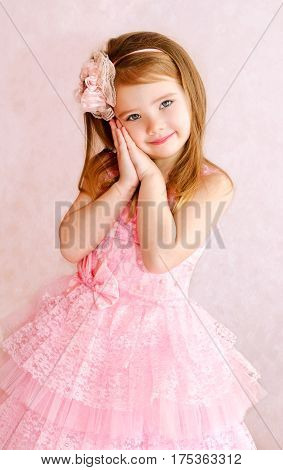 Portrait of adorable smiling little girl in princess dress isolated