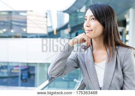Businesswoman looking far away at outdoor