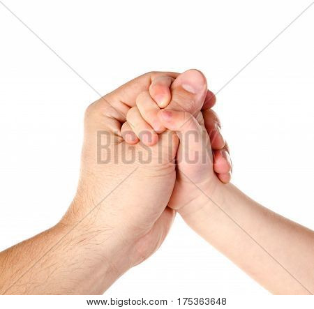 Child holds father's finger isolated on a white