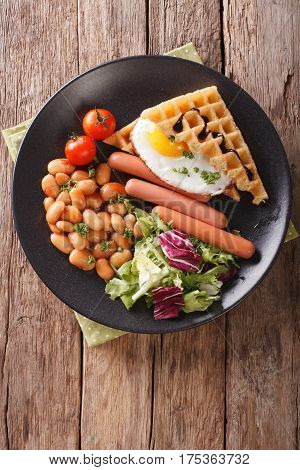 Savory Breakfast: Waffles With Egg, Sausages, Beans And Fresh Salad Close-up. Vertical Top View