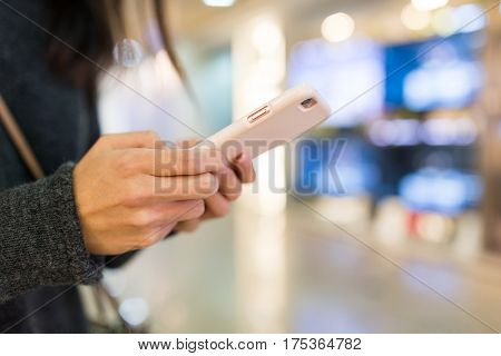 Woman sending text message on smart phone