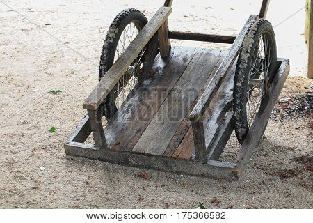 wooden barrow old two wheel on the ground