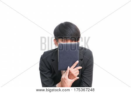 student holding book on white background .