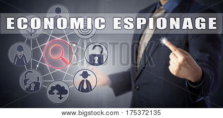 Male cyber detective in blue business suit is investigating an ECONOMIC ESPIONAGE case. Corporate crime concept and cybersecurity metaphor for business intelligence and cyberwarfare.