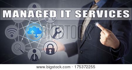 Male enterprise consultant in blue suit introducing a MANAGED IT SERVICES solution. Information technology concept and business processes metaphor for outsourced service providers handling IT needs.