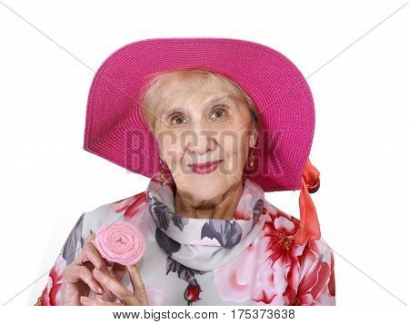 Smiling senior female wearing red hat and holding a flower in the hands studio headshot isolated on white