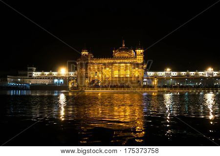 Nightly view of Golden Temple - Sikhs holy place in Amritsar - India