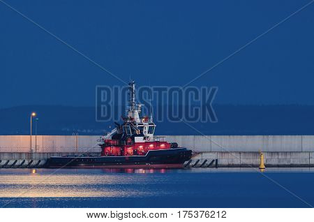 FIREBOAT - Fireboat in the port on a moonlit night