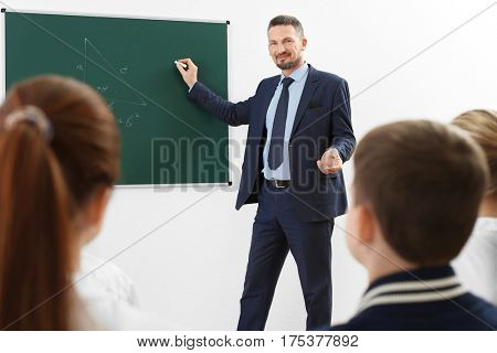 Male teacher conducting lesson in classroom