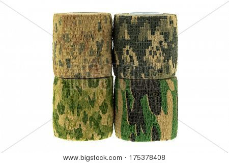 Closeup rolls of fabric camouflage pattern stretchable bandage tape for hiding, disguising gun, camera, other outdoor hunting, isolated on white background