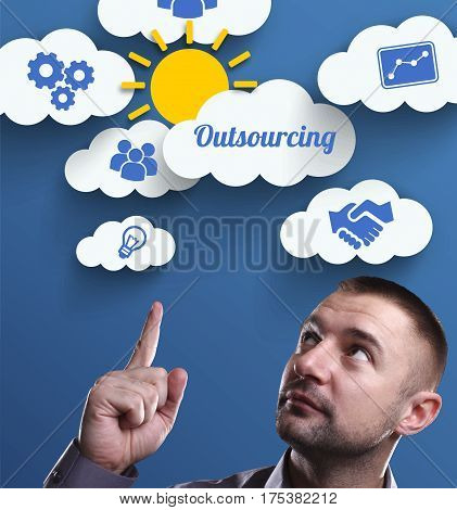 Business, Technology, Internet And Marketing. Young Businessman Thinking About: Outsourcing