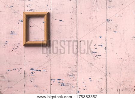 vintage photo frame on old pink wooden wall