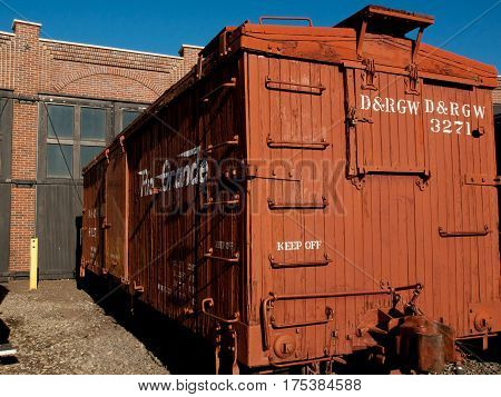 Denver Colorado-November 29 2011: Vintage boxcar built of wood at front of the roundhouse.