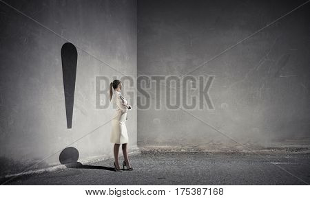 Businesswoman in empty room . Mixed media
