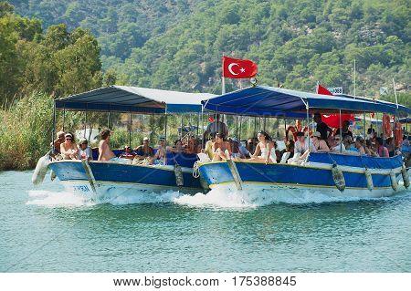 MUGLA, TURKEY - AUGUST 13, 2009: Unidentified tourists enjoy river cruise by the Dalyan river in Mugla, Turkey.