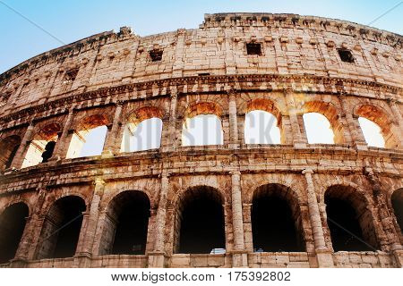 The iconic ancient Colosseum of Rome. View in sunrise .