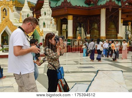 People Praying At Shwedagon In Yangon
