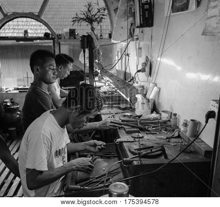 Burmese Men Working At A Jewellery Shop