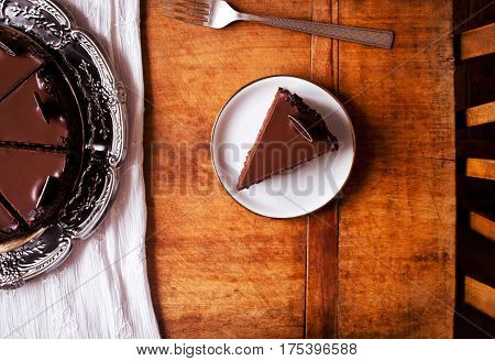 Perfect chocolate cake on wooden table, directly above