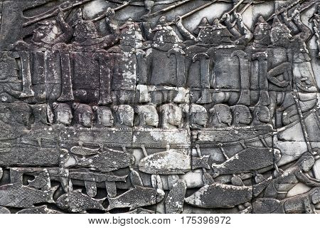 Ancient reliefs on the temple wall in Angkor, Cambodia