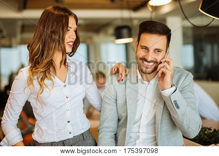 Portrait of a business couple getting their jobs done during meeting.