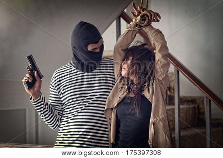 Woman Kidnapped By Criminals. Terrorist Is Threatening Hostages With A Gun.