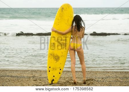 Pretty Girl Surfer In Swimsuit Holding Yellow Surfboard