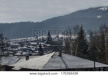 Landscape of snowy winter roofs in the Koprivshtitsa town, Bulgaria