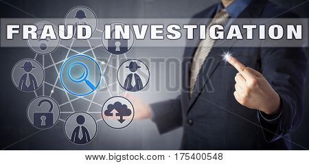 Male corporate manager in blue shirt and suit is activating FRAUD INVESTIGATION. Information technology metaphor and computer security concept for the hunt of a civil or criminal fraudster.