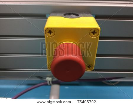 The red emergency button or stop button for Hand press. STOP Button for industrial machine
