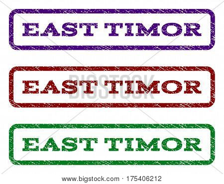 East Timor watermark stamp. Text caption inside rounded rectangle frame with grunge design style. Vector variants are indigo blue, red, green ink colors. Rubber seal stamp with dirty texture.