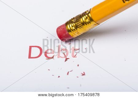 Debt Word is Erased by a Pencil Erase - Close Up