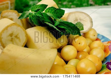 Delicious Bananas And Cherry Plums On Colorful Plate Appetizer, Yellow Color, Picnic Outdoors, Cater