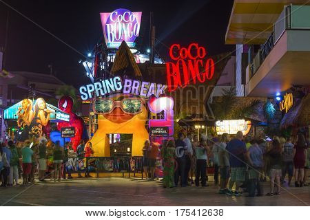CANCUN MEXICO - FEBRUARY 28 2017: Tourists stand in long lines to enter the popular Conco Bongo nightclub in Cancun at the start of Spring Break